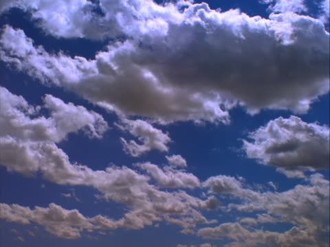 rolling clouds with sunlight above - mpeg video format stock videos & royalty-free footage