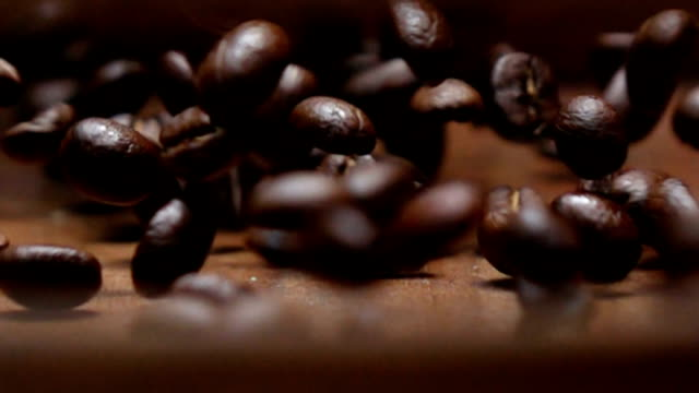 Rolling coffee beans in slow motion shot