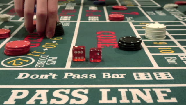 rolling dice on the casino crap table - dice stock videos & royalty-free footage