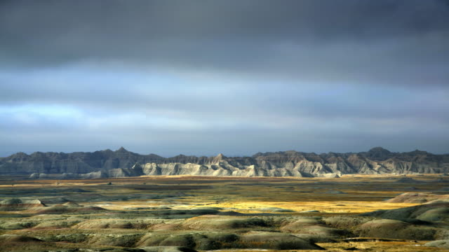 rolling hills and farm land - badlands national park video stock e b–roll