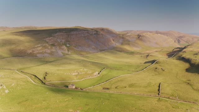 Rolling Hills and Limestone Cliffs in Yorkshire Dales - Drone Shot