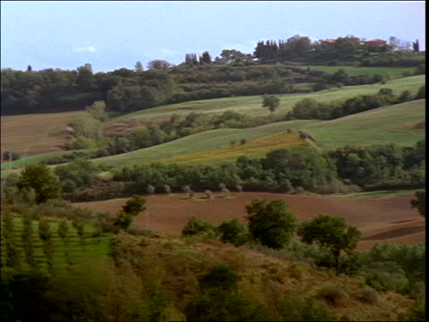 pan of rolling hills in tuscan countryside / italy - tuscany stock videos & royalty-free footage