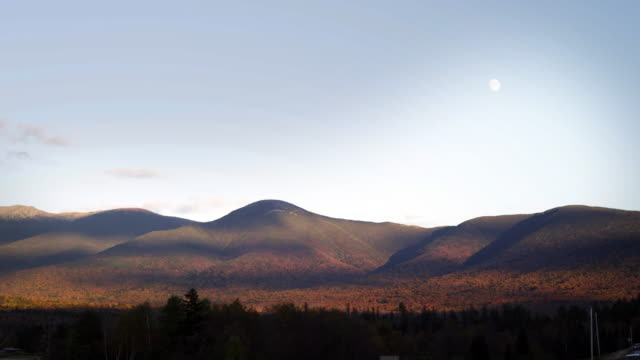 Rolling hills of Northern Vermont with daytime moon