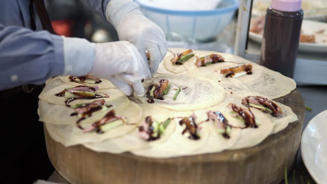 rolling on peking duck, street food. - serving size stock videos & royalty-free footage