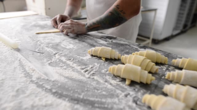 rolling perfect croissant is an art - artisanal food and drink stock videos & royalty-free footage