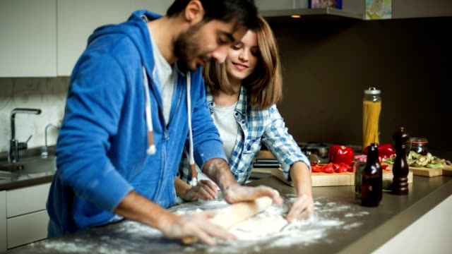 rolling pizza dough - young couple stock videos & royalty-free footage