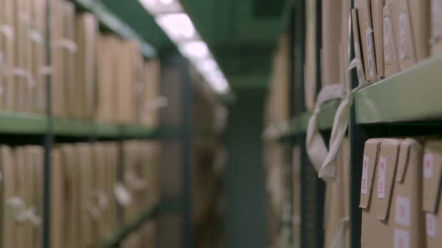 vídeos de stock, filmes e b-roll de rolling shelves separate to reveal lighting - bbc archives