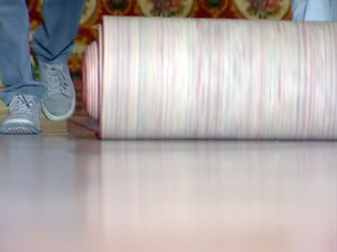 rolling the carpet - carpet stock videos & royalty-free footage