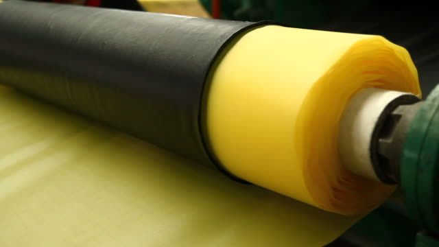 rolling the material - polyethylene stock videos and b-roll footage