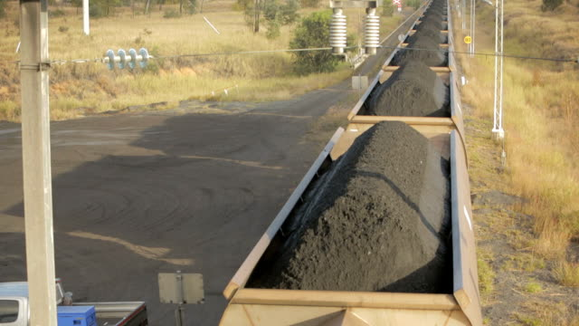 rolling train carriages filled with coal - mining stock videos and b-roll footage
