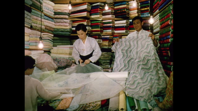 montage rolls of colorful fabric in korea - korea stock videos & royalty-free footage