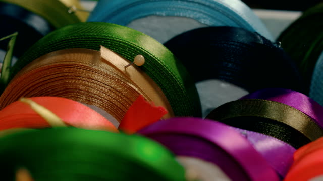 rolls of multicolored silk ribbons in fabric store - ribbon stock videos & royalty-free footage
