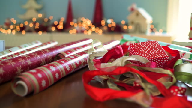 rolls of paper and ribbons for wrapping christmas presents - wrapped stock videos & royalty-free footage