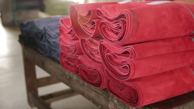 Rolls of processed leather sits stacked at the Sheong Shi Tannery in Kolkata West Bengal India on Tuesday Dec 26 2017