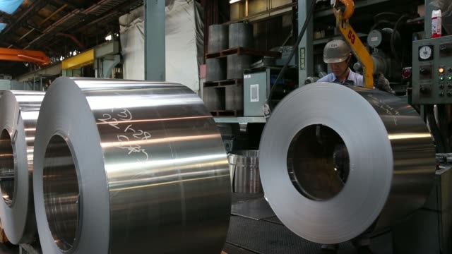 rolls of sheet aluminum sit on the production line at the akao aluminum co plant in tokyo japan on monday feb 17 various shots an employee operates a... - aluminum sheet stock videos and b-roll footage