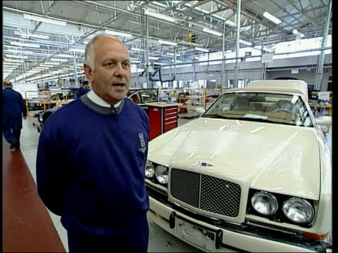 german takeover itn england cheshire crewe int worker at rolls royce factory opening and shutting door of car worker pulling up mascot of car from... - rolls royce stock videos & royalty-free footage