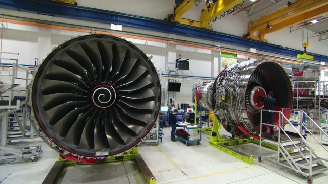 rolls royce fined 671 million pounds for corruption; derbyshire: derby: int various shots workers manufacturing rolls royce jet engines in factory - rolls royce stock videos & royalty-free footage