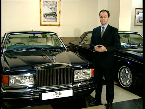 london i/c in rolls royce showroom next cars spirit of ecstasy statue on bonnet tilt down to rr logo unspecified int sir colin chandler intvwd sot... - rolls royce stock videos & royalty-free footage