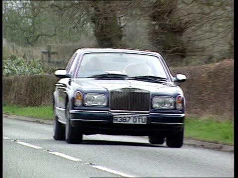 vídeos de stock, filmes e b-roll de rolls royce takeover lib cheshire crewe rolls royce driving along country road - rolls royce