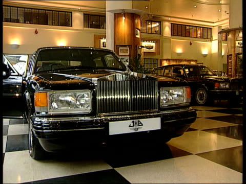 rolls royce takeover lib rolls royce cars in showroom cs silver statue on bonnet cs ditto - rolls royce stock videos & royalty-free footage