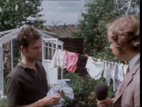 rolls royce unemployment:; england: derbyshire: derby: ext nv peter casebow walkes to washing line: 2 children follow bv he unpegs clothes from line;... - outdoors stock videos & royalty-free footage