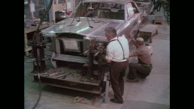 rolls-royce body assembly montage - production line worker stock videos & royalty-free footage