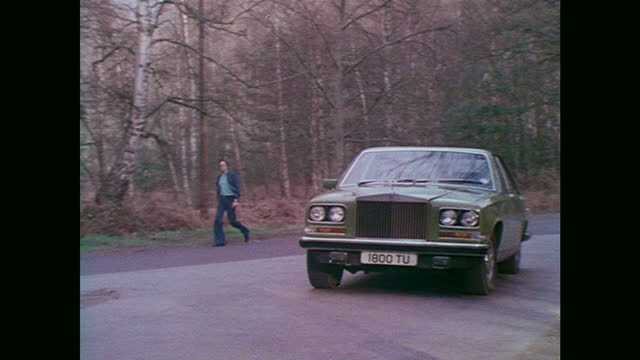 rolls-royce camargue driving on a country road - 1976 stock videos & royalty-free footage