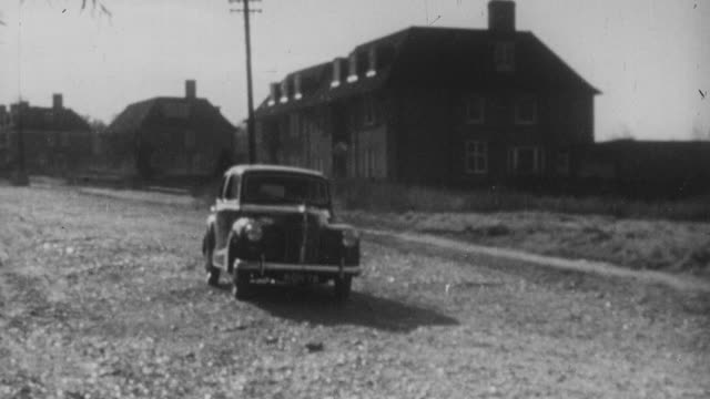 1952 ts rolls-royce driving on a rural street / england - rolls royce stock videos and b-roll footage