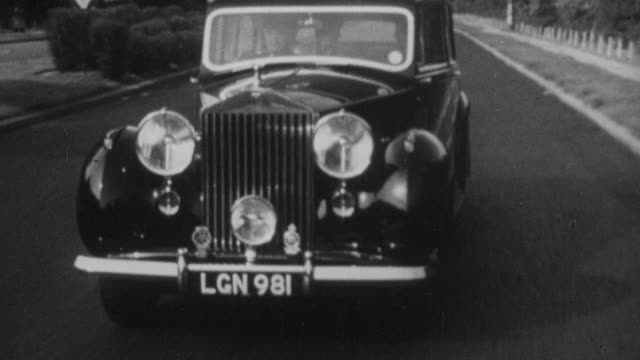 1952 montage a rolls-royce driving through urban and rural streets / england - rolls royce stock videos and b-roll footage