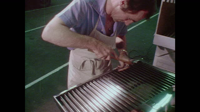 rolls-royce worker assembling front grille - production line worker stock videos & royalty-free footage