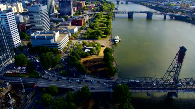 rom 390' in the air over Waterfront Park we see morning traffic in Portland