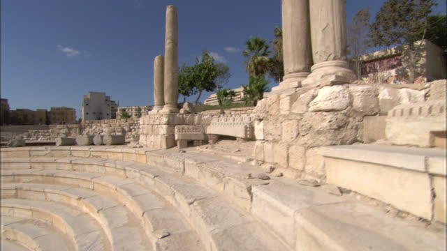 a roman amphitheater and a communication tower in alexandria, egypt. - amphitheatre stock videos & royalty-free footage