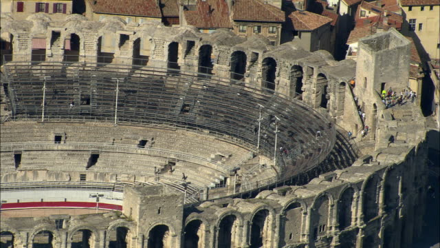 zo, aerial, roman amphitheatre and view of arles, provence-alpes-cote d'azur, france - amphitheatre stock videos & royalty-free footage