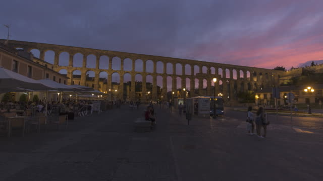 roman aqueduct in the twilight (unesco world heritage site) - spanish culture stock videos & royalty-free footage