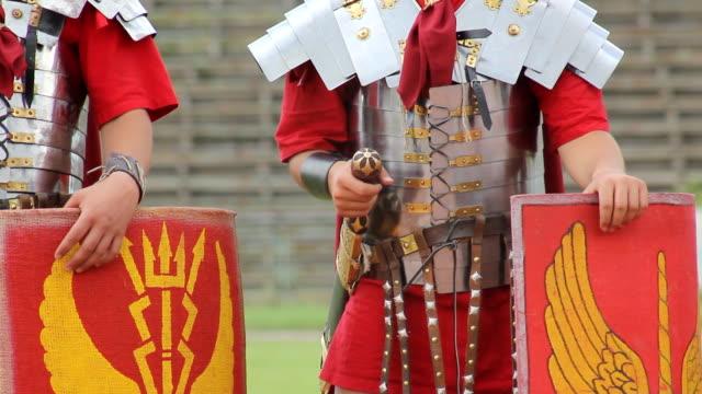 vídeos de stock, filmes e b-roll de hd exército romano - concorrente