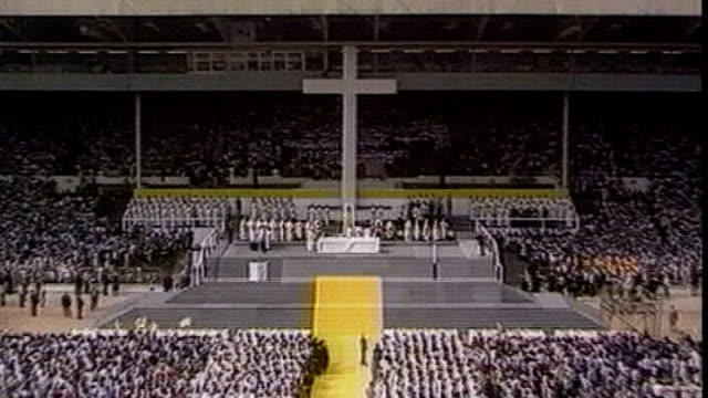 Pope John Paul II to be made a saint TX ENGLAND London Wembley Stadium large platform and cross at stadium as mass held by Pope John Paul II during...