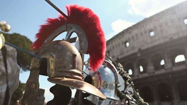 roman centurion soldier helmets and the coliseum - army stock videos & royalty-free footage