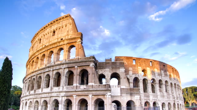 roman colosseum 4k time lapse during sunset in rome, italy. - royalty stock videos & royalty-free footage