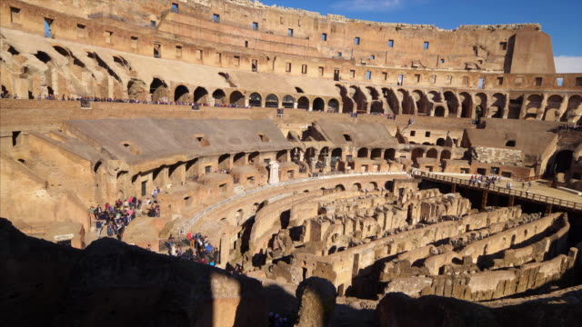 stockvideo's en b-roll-footage met roman colosseum interior shows architectural details in rome, italy (slow tilt up) - amfitheater