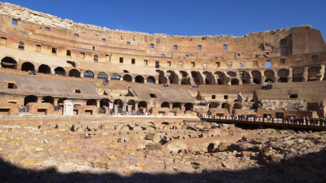 vidéos et rushes de roman colosseum interior shows architectural details in rome, italy - gladiateur