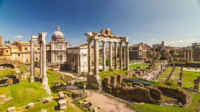 Roman Forum Timelapse with Temple of Saturn and people crowd at sunny day. Rome, Italy. April, 2016.