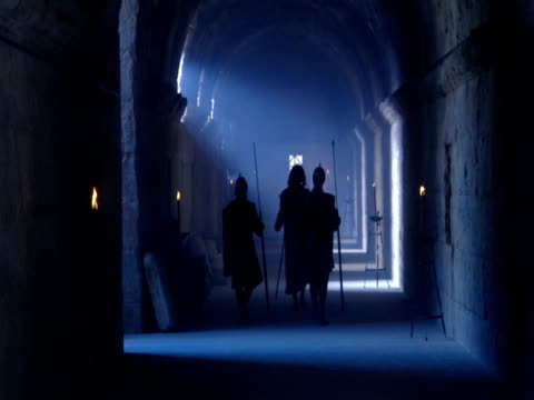 roman guards escort jesus through a dim corridor. - reenactment stock videos & royalty-free footage