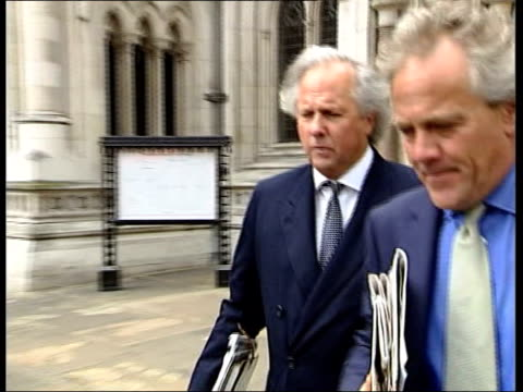 stockvideo's en b-roll-footage met london high court graydon carter out of court with his layer and walks past press pan ms deborah tate away from court with unidentified woman track - roman polanski