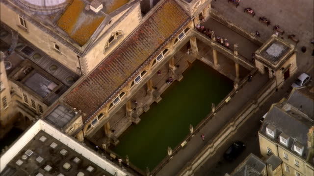 low aerial, roman public baths, bath, sommerset, england - somerset england stock videos & royalty-free footage