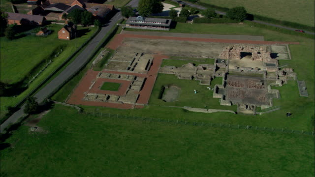 roman remains at wroxeter - aerial view - england, shropshire, united kingdom - old ruin stock videos and b-roll footage