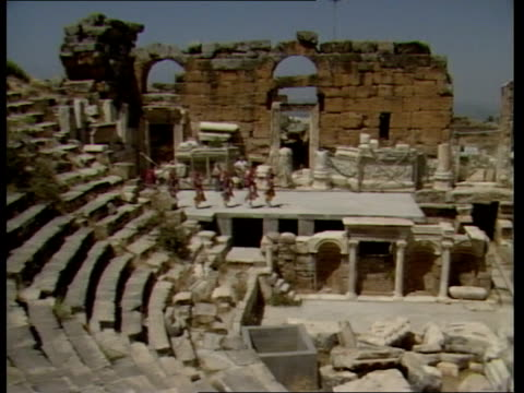 roman remains lms folk dancers onto roman theatre stage ms dancers ms ditto ts ditto ms ditto gv stones in haphazard formation gv ditto - amphitheatre stock videos & royalty-free footage
