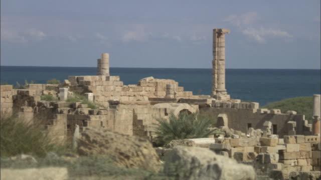 MS PAN Roman ruin of Leptis Magna wall dividing in column / Al Khums, Al Khums District, Libya