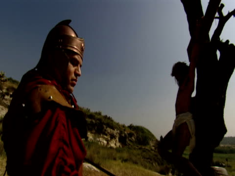 a roman soldier sponges the brow of christ on the cross. - roman soldier stock videos and b-roll footage