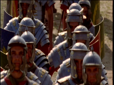roman soldiers march along a road. - roman soldier stock videos and b-roll footage