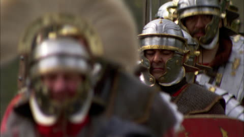 roman soldiers march in single file. - historical reenactment stock videos & royalty-free footage